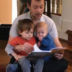 Christopher Reading to His Young Kids