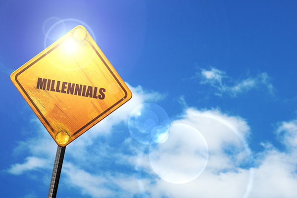 millennials: yellow road sign with a blue sky and white clouds